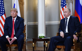 Russian President Vladimir Putin and US President Donald Trump attend a meeting in Helsinki.