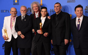 Bohemian Rhapsody winner Rami Malek poses with Graham King (second from right), Brian May (third from left) and Mike Myers (far right) during the 76th annual Golden Globe Awards.