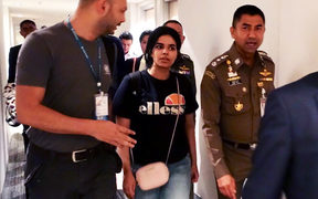 January 7, 2019 18-year-old Saudi woman Rahaf Mohammed al-Qanun (2nd-L) escorted by the Thai immigration officer and United Nations High Commissioner for Refugees (UNHCR) officials at the Suvarnabhumi international airport in Bangkok.