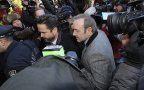 US actor Kevin Spacey wades through a media frenzy as he makes his appearance during his arraignment on January 7, 2019 at the Nantucket District Court, in Nantucket, Massachusetts.