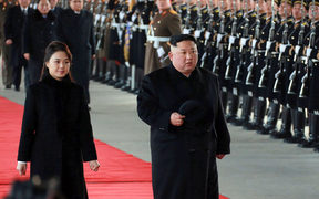North Korean leader Kim Jong-un (right) and his wife Ri Sol-Ju leaving Pyongyang Station to visit China.