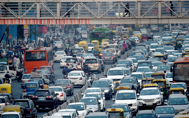 Commuters in their vehicles clog the roads of New Delhi.