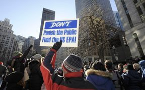 An EPA employee holds a sign during a protest rally by government workers and concerned citizens against the government shutdown on Friday, January 11, 2019 at Post Office Square near the Federal building, headquarters for the EPA and IRS in Boston.AFP