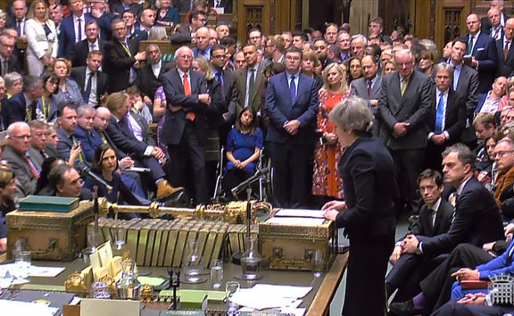 A video grab from footage broadcast by the UK Parliament's Parliamentary Recording Unit (PRU) shows Britain's Prime Minister Theresa May (R) as she speaks in the House of Commons in London on January 15, 2019, after MPs voted to reject the government's Brexit deal.