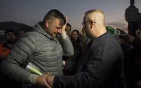 Jose Rosello (L), father of Julen who fell down a well, cries as rescue efforts continue to find the boy in Totalan in southern Spain.