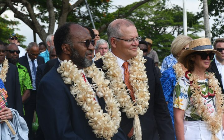 Scott Morrison with Carlot Salwai (left) during his visit to Vanuatu