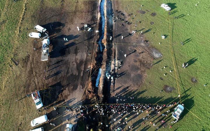Aerial view of the scene where a massive blaze trigerred by a leaky pipeline took place.