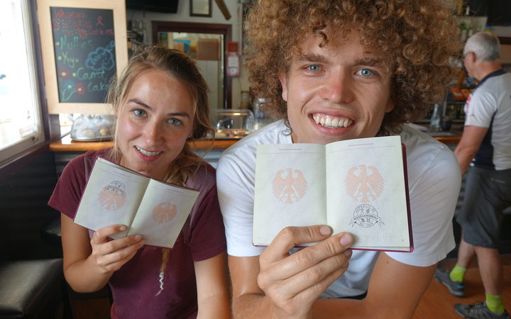 Tourists with their passports stamped.