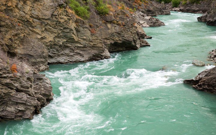 Two men got caught in rapids on the Kawarau River on an inflatable matress.
