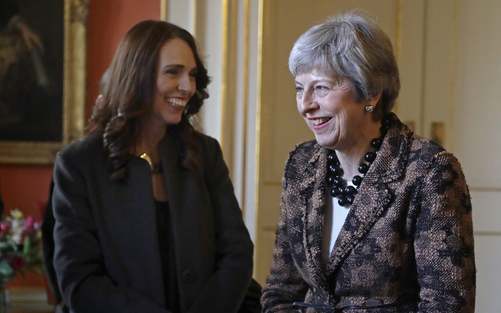 British Prime Minister Theresa May shares a joke with Prime Minister Jacinda Ardern inside 10 Downing Street.