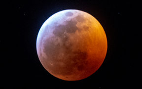 Earth's shadow almost totally obscures the view of the so-called Super Blood Wolf Moon during a total lunar eclipse.