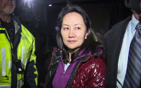 Huawei Technologies Chief Financial Officer Meng Wanzhou exits the court registry following a bail hearing at British Columbia Superior Courts in Vancouver on December 11, 2018.
