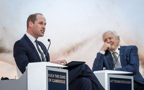 Prince William and Sir David Attenborough talk during the World Economic Forum (WEF) in Davos, Switzerland.