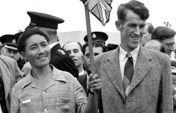 (FILES) Picture dated 03 July 1953 of Mount Everest conquerors Edmund Hillary (R) and Sherpa Tenzing Norgay (L) at London's Heathrow airport on their arrival from the expedition.