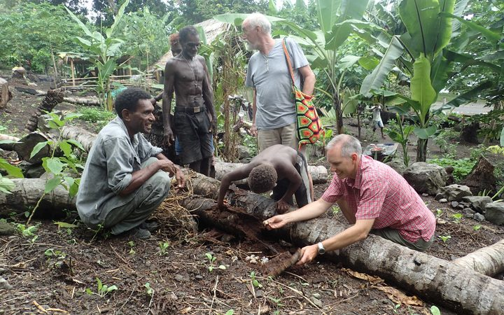 Scientists Sean Marshall and Bob Macfarlane expaining Coconut Rhinoceros Beetle invasion to Solomon Islands villagers