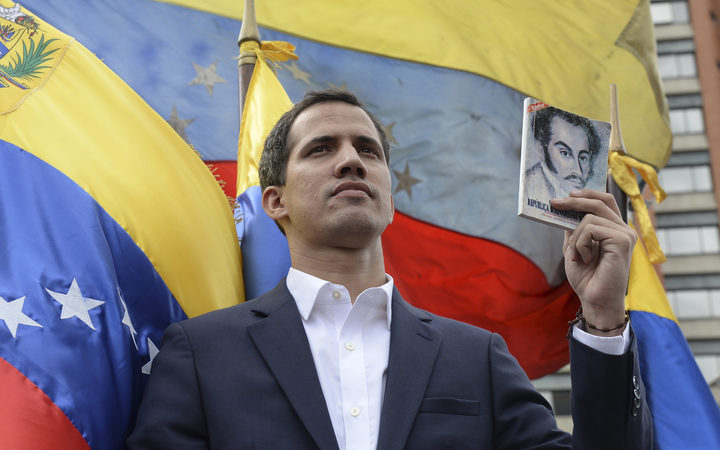 "Venezuela's National Assembly head Juan Guaido declares himself the country's ""acting president"" during a mass opposition rally."