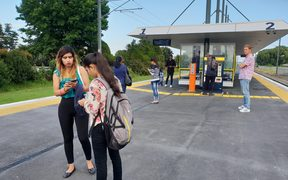 Stranded passengers await for updates on the train situation at Takanini train station.