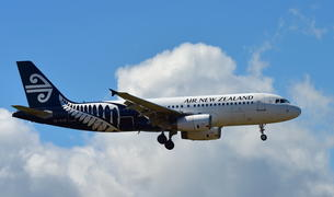 Air New Zealand Airbus A320 landing at Auckland International Airport.