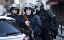 Armed police stand guard after  knife-wielding man was shot dead on the anniversary of the Charlie Hebdo attacks.