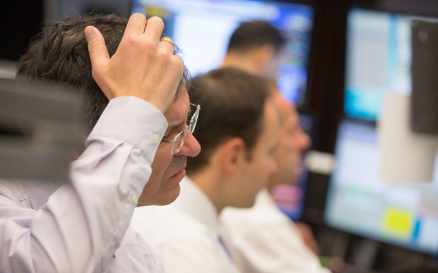 German stock traders watch as the market  is rattle by Chinese volatility.