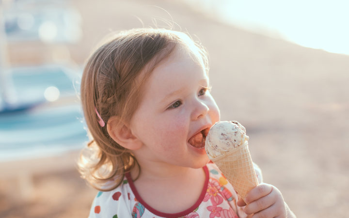 Cute little girl eating ice-cream