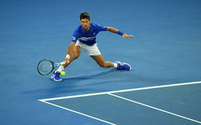 Serbia's Novak Djokovic plays a forehand return against Spain's Rafael Nadal during the men's singles final on day 14 of the Australian Open tennis tournament in Melbourne.