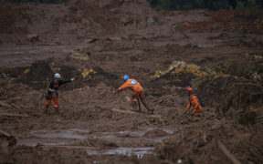 Rescuers search for vicitms in the mud-hit community of Casa Grande two days after the collapse of a dam at an iron-ore mine belonging to Brazil's giant mining company Vale near the town of Brumadinho, state of Minas Gerias, southeastern Brazil, on January 27, 2019.
