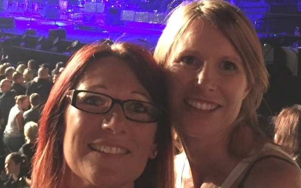 Jo Pert, right, with her cousin at a Robbie Williams concert.
