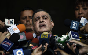 "Venezuelan Prosecutor Tarek William Saab, delivers a statement at the Supreme Court of Justice in Caracas to announce he has asked the Supreme Court to bar Venezuela's self-proclaimed ""acting president"" Juan Guaido, from leaving Venezuela and to freeze his assets."