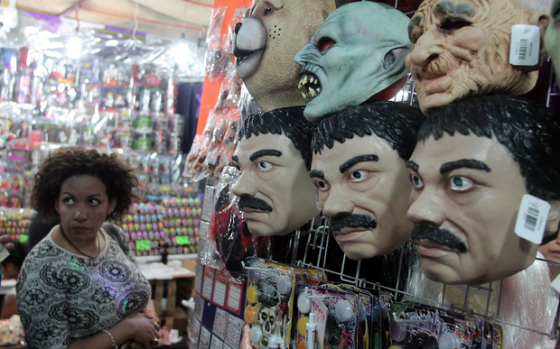 Masks of famous Mexican drug trafficker currently on the run Joaquin Guzman Loera 'El Chapo' are pictured in a costume shop in central Mexico.