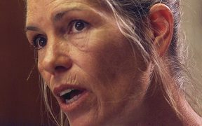 Leslie Van Houten expresses remorse in the killings of the LaBianca couple to members of the Board of Prison Terms commissioners during her parole hearing 28 June 2002.
