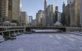 Ice covers the Chicago River today in Chicago.