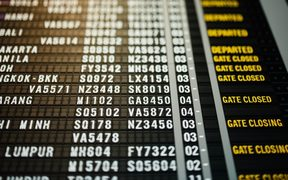 Airport departure board Photo by chuttersnap on Unsplash