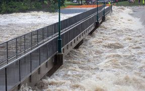 This recent undated handout picture provided by the Queensland Fire and Emergency Services and received by AFP on February 3, 2019 shows floodwaters as they rush over the Aplins Weir in Townsville after days of torrential rain.
