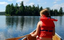 Girl in canoe wearing lifejacket