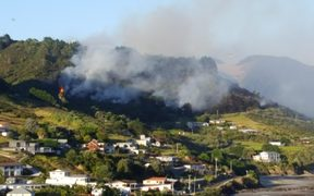 A bush fire is threatening homes around Shipwreck Bay.