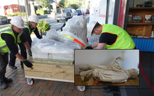 The statue of Robert Scott is moved to the  Canterbury Museum's Quake City exhibition.