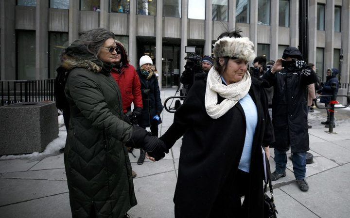 Shelly Kinsman (R) leaves the Toronto Courthouse in Toronto, Canada on February 8, 2019 after the sentencing of Toronto serial killer Bruce McArthur. Shelly's brother Andrew Kinsman was one of McArthur's victims.