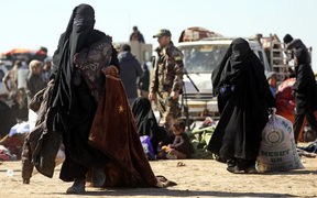 Civilians flee fighting between Syrian Democratic Forces (SDF) and Islamic State (IS) jihadists in the frontline Syrian village of Baghuz.