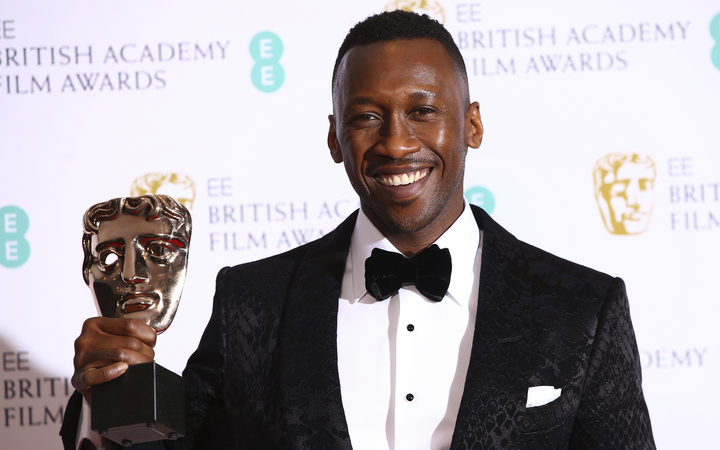 No Actor Mahershala Ali poses for photographers backstage with the Best Supporting Actor award for his role in the film Green Book.