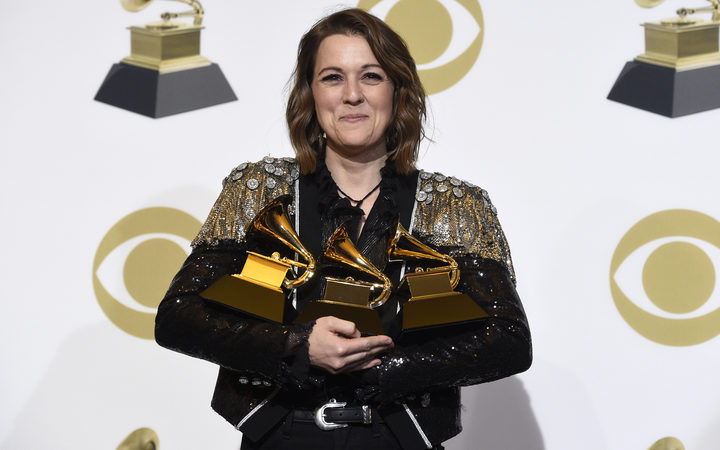 "Brandi Carlile, winner of the awards for best Americana album for ""By The Way, I Forgive You"", best American roots performance for ""The Joke"", and best American roots song for ""The Joke"" poses at the 61st annual Grammy Awards at the Staples Center on Sunday, Feb. 10, 2019, in Los Angeles. ("