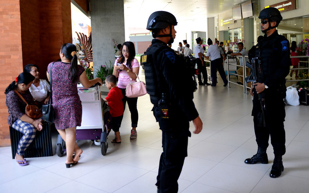 Indonesian Special Police patrol at Ngurah Rai Airport in Bali one day after a deadly attack reportedly orchestrated by Islamic State.