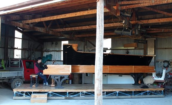Adrian Mann and his long piano