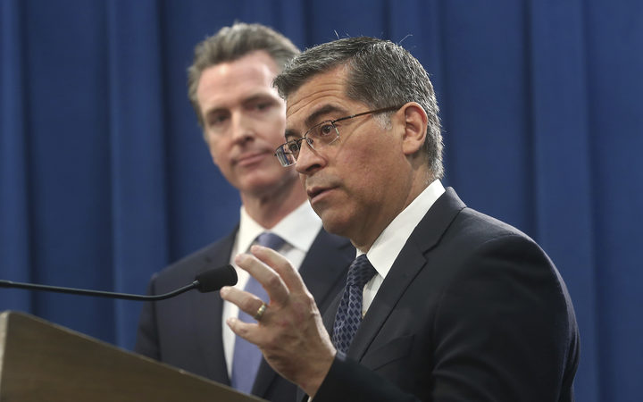 California Attorney General Xavier Becerra, right, accompanied by Gov. Gavin Newsom, said California will probably sue President Donald Trump over his emergency declaration to fund a wall on the U.S.-Mexico border