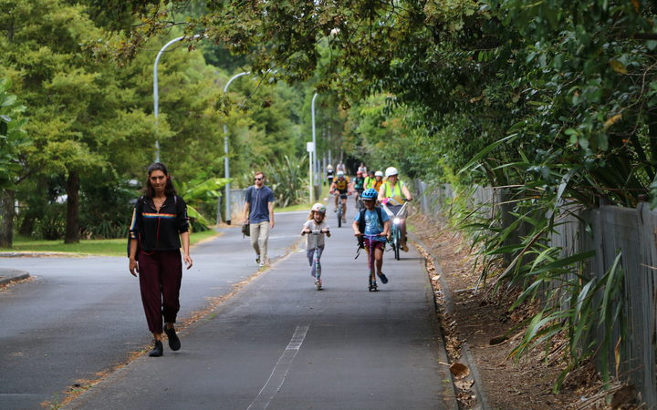 Pedestrians, scooter and bike riders on the northwestern cycleway.