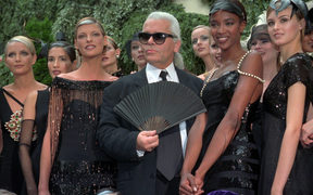 Karl Lagerfeld with Canadian model Linda Evangelista, left, and British model Naomi Campbell, right, and other models after the presentation of his 1996-97 fall-winter haute couture fashion collection for Chanel in Paris.