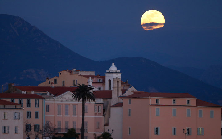 A 'Super Snow Moon' rise over Ajaccio on the French Mediterranean island of Corsica, on February 19, 2019.