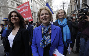 British MPs, from left, Heidi Allen, Anna Soubry and Sarah Wollaston arrive for a press conference at Westminster to announce their resignation from the Conservative Party.
