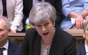Britain's Prime Minister Theresa May as she speaks during Prime Minister's Questions in the House of Commons in London on February 13, 2019