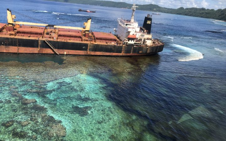 The MV Solomon Trader stuck on a reef off of Rennell Island in the Solomon Islands is leaking oil into the ocean. February 2019.